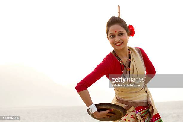 Portrait of Bihu woman dancing with brass plate