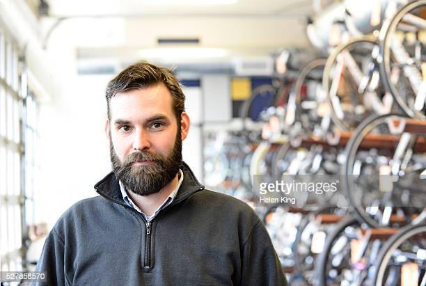 portrait of bike shop owner - mid adult men ストックフォトと画像