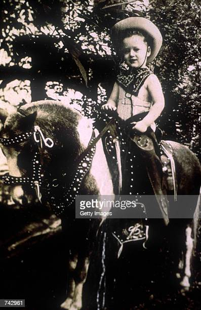 Portrait of Bill Clinton riding a horse at the age of 45 years in 1950
