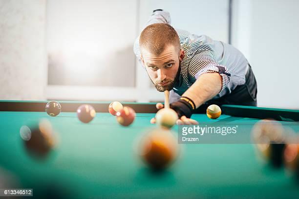 Portrait of billiard player aiming