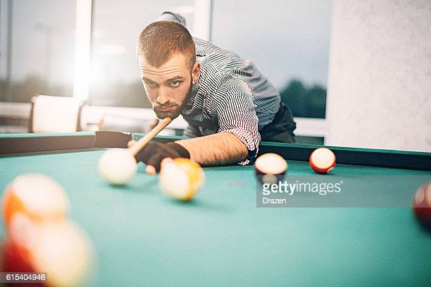 Portrait of billiard player aiming