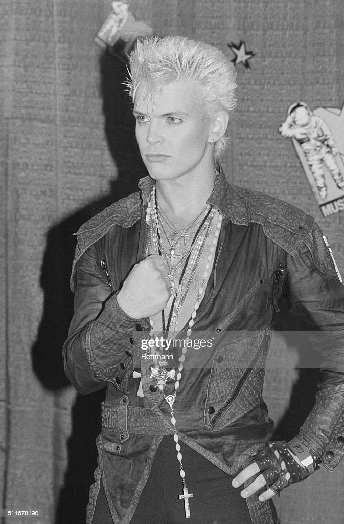 A Portrait Of Billy Idol Draped In Necklaces And Bleach Blonde