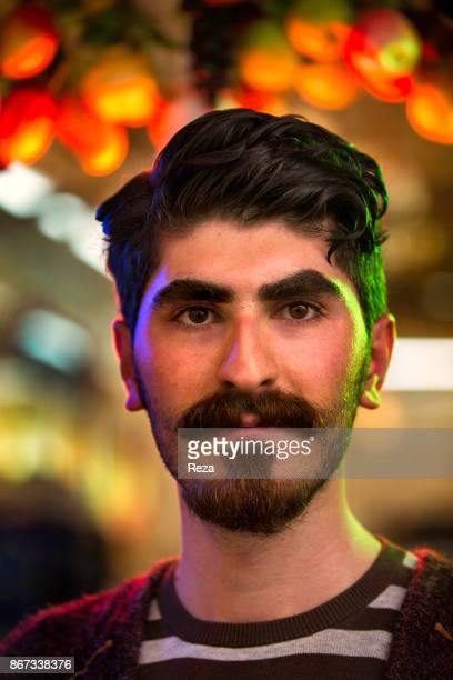 Portrait of Birwa Ahmad a 20 years old university student working during summer as a fruit juice seller in Sulaymaniyah's bazaar