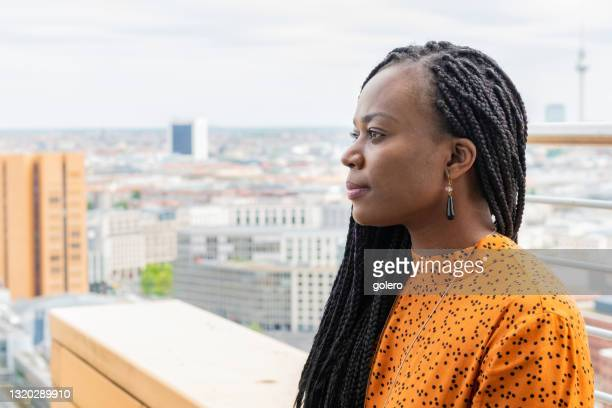 portrait of black business woman at rooftop in berlin - 35 39 years stock pictures, royalty-free photos & images