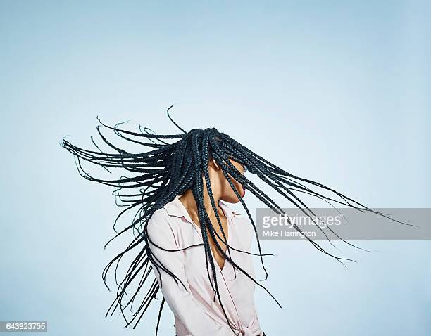 portrait of black female flicking hair - braided stock pictures, royalty-free photos & images