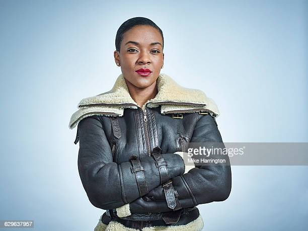 portrait of black female with short hair - leather stock pictures, royalty-free photos & images