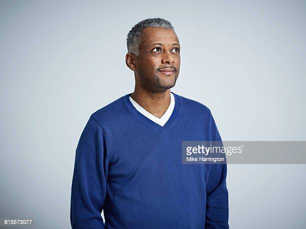 portrait of black male in blue jumper - looking away stock pictures, royalty-free photos & images