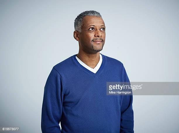 Portrait of black male in blue jumper