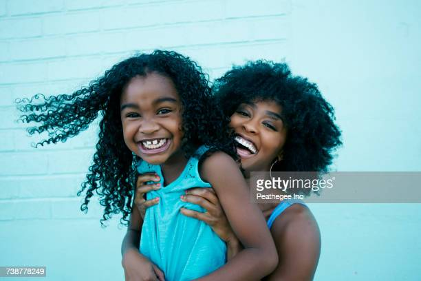 portrait of black mother and daughter laughing - funny black girl stock photos and pictures