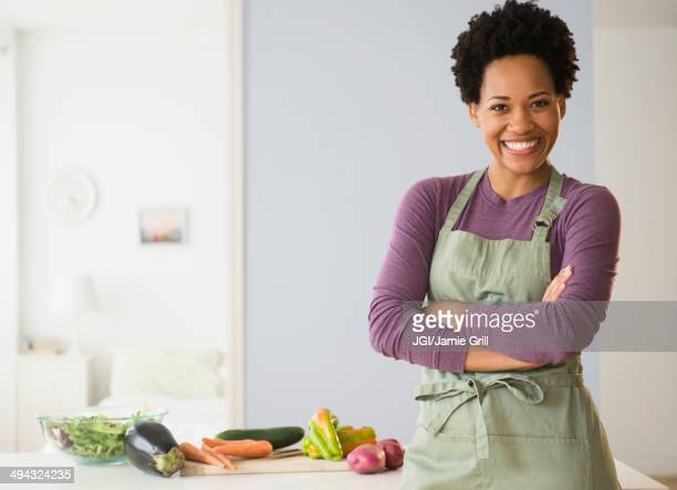 Portrait of black woman cooking in kitchen