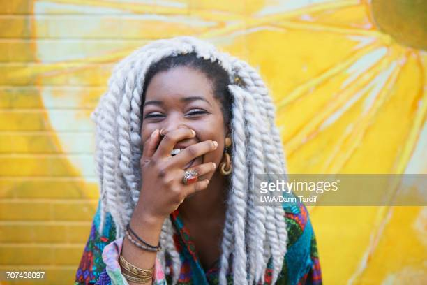 portrait of black woman laughing - black people laughing stock photos and pictures