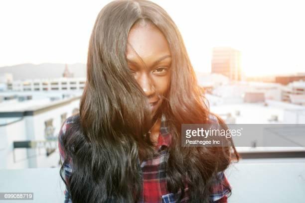 Portrait of Black woman on rooftop