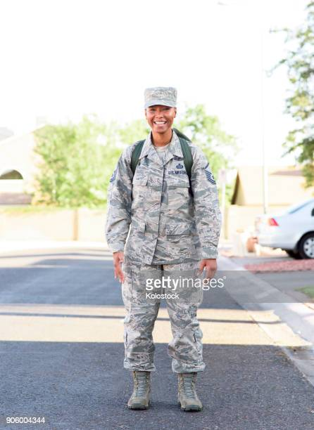 portrait of black woman soldier standing in street - military uniform stock pictures, royalty-free photos & images