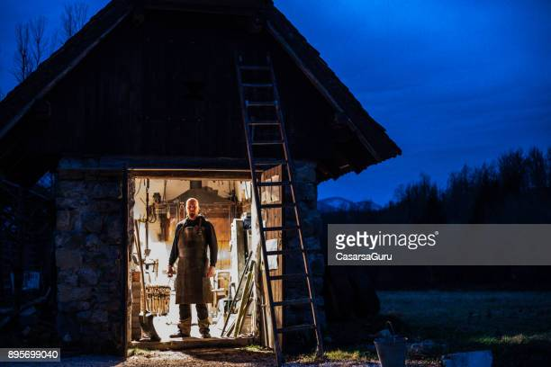 Portrait of Blacksmith and his Forge at Twilight
