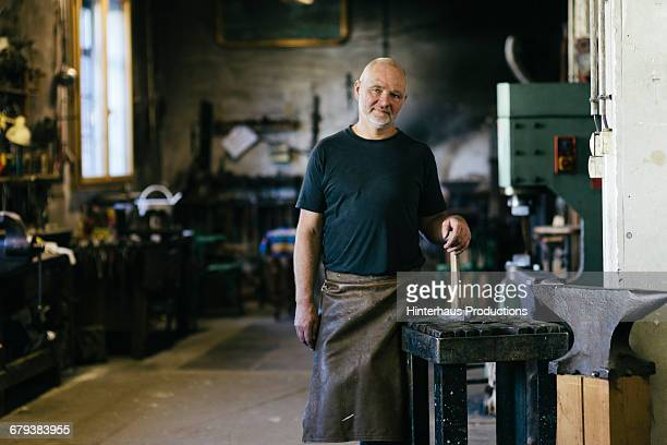 Portrait of blacksmith  with hammer