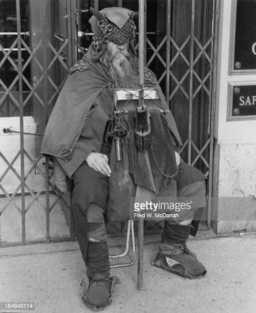 Portrait of blind American composer, musician, poet, and eccentric Moondog as he sits outside the Underwriters Trust Company doorway , New York, New...