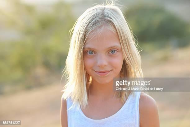 Portrait of blond blue eyed girl, Buonconvento, Tuscany, Italy
