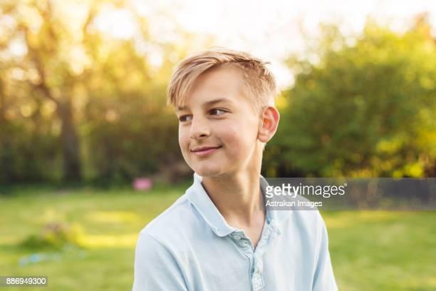 Portrait of blond boy (12-13) looking away