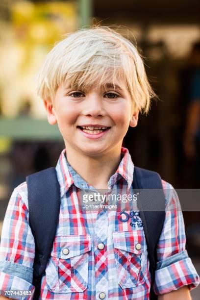 Portrait of blond boy smiling