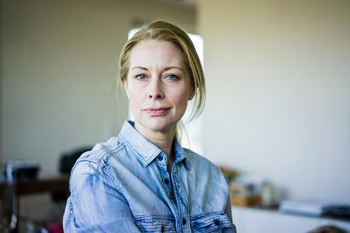 Portrait of blond businesswoman wearing denim shirt - gettyimageskorea