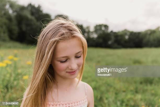 portrait of blond girl in nature - guardare verso il basso foto e immagini stock