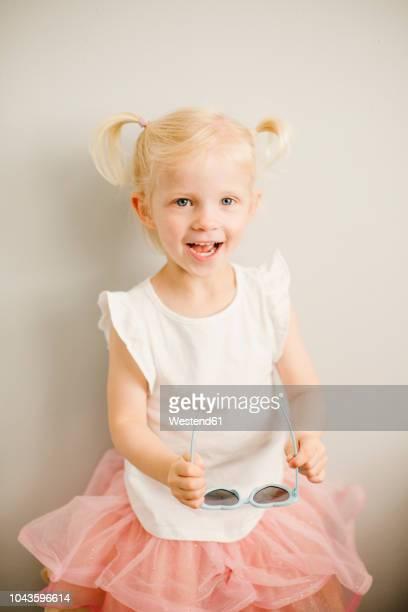 portrait of blond little girl - 金髪 ストックフォトと画像