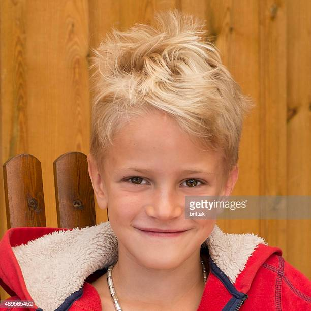 portrait of blond seven years old boy with wide smile. - 6 7 years stock pictures, royalty-free photos & images