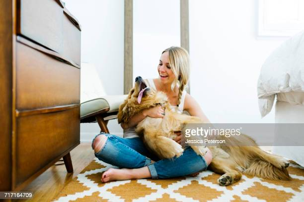 portrait of blond woman with golden retriever - americas next top dog stock pictures, royalty-free photos & images