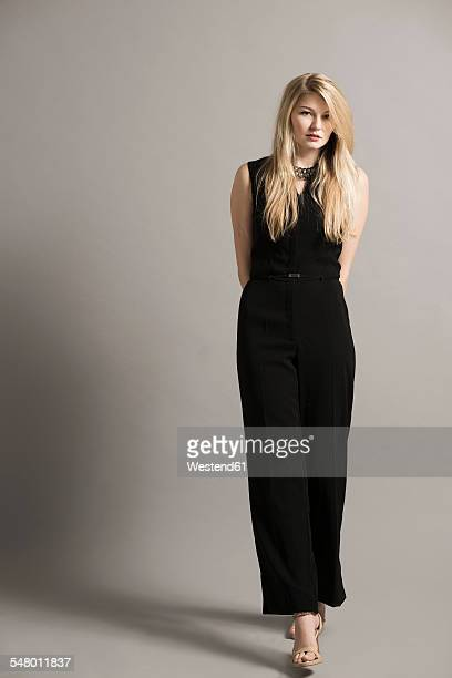 portrait of blond young woman wearing black overall - evening wear stock pictures, royalty-free photos & images