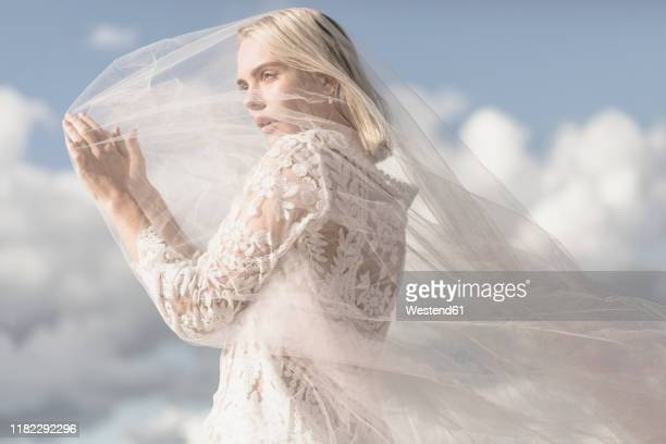 portrait of blond young woman with veil - veil stock pictures, royalty-free photos & images
