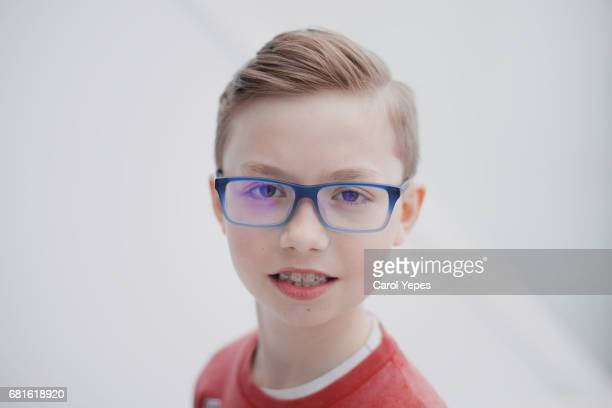 portrait of blonde boy with eyeglasses