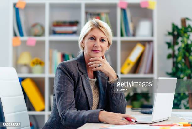 Portrait of blonde businesswoman working in office