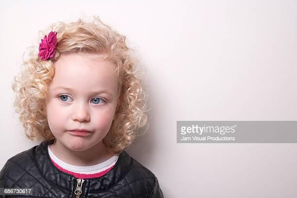 Portrait of blonde girl (4-5) on white background