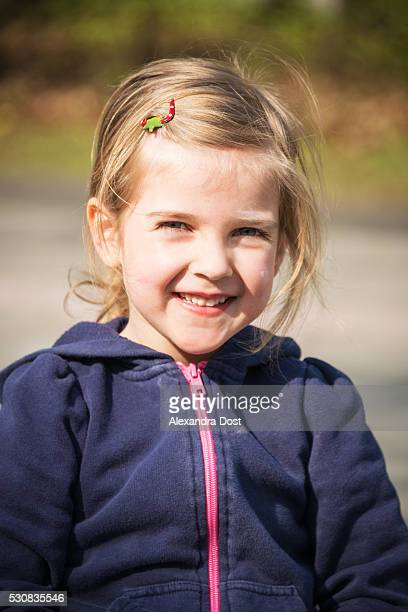 portrait of blonde girl, smiling, munich, bavaria, germany - alexandra dost stock-fotos und bilder