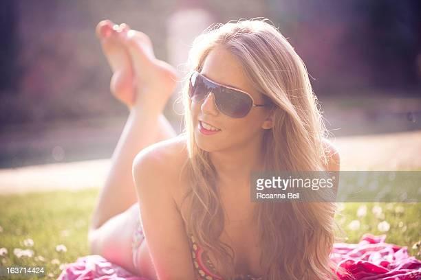 Portrait of Blonde Girl Sunbathing in the Sun