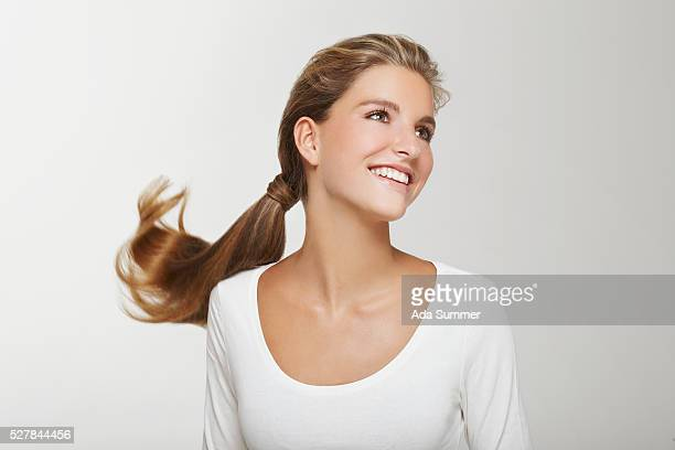 portrait of blonde hair woman with ponytail - ponytail stock pictures, royalty-free photos & images