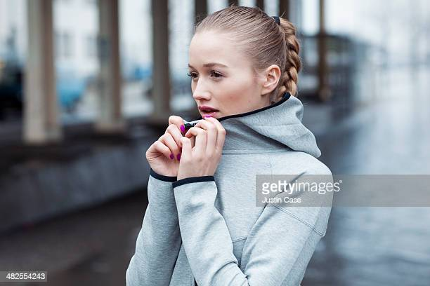 Portrait of blonde sporty woman in city scape