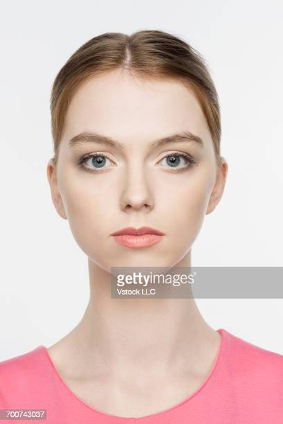Portrait of blonde young woman on white background