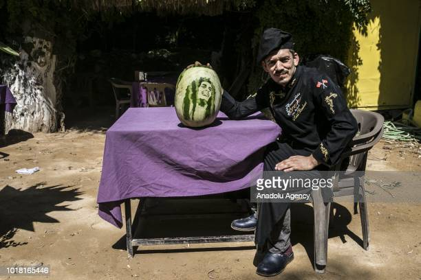 A portrait of Bob Marley carved on a watermelon by cook Halil Bozkurt is seen in Turkey's Hatay on August 17 2018 Bozkurt carves portraits of well...