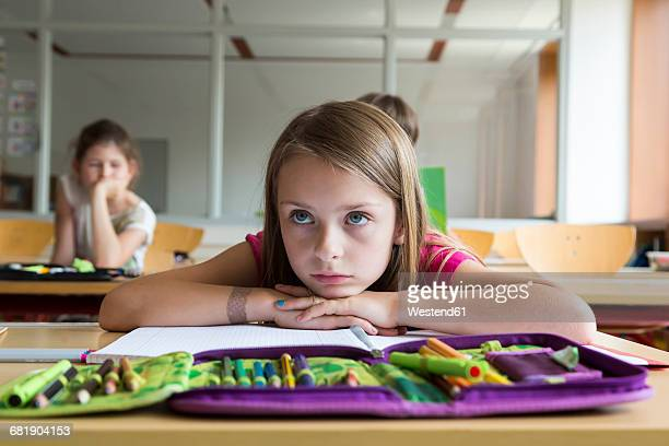 portrait of bored schoolgirl at class - pencil case stock pictures, royalty-free photos & images
