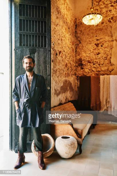 portrait of boutique owner standing in doorway of shop - suave stock pictures, royalty-free photos & images