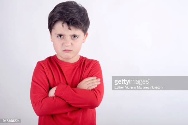 portrait of boy against white background - anger stock pictures, royalty-free photos & images