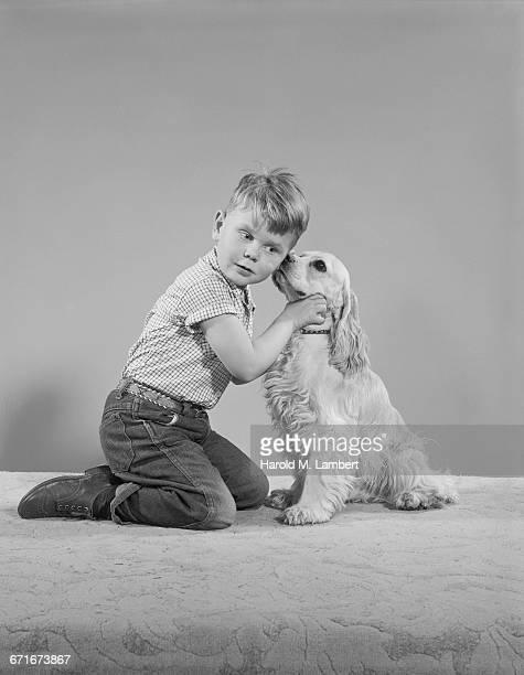 portrait of boy and dog sitting together - {{ contactusnotification.cta }} stockfoto's en -beelden