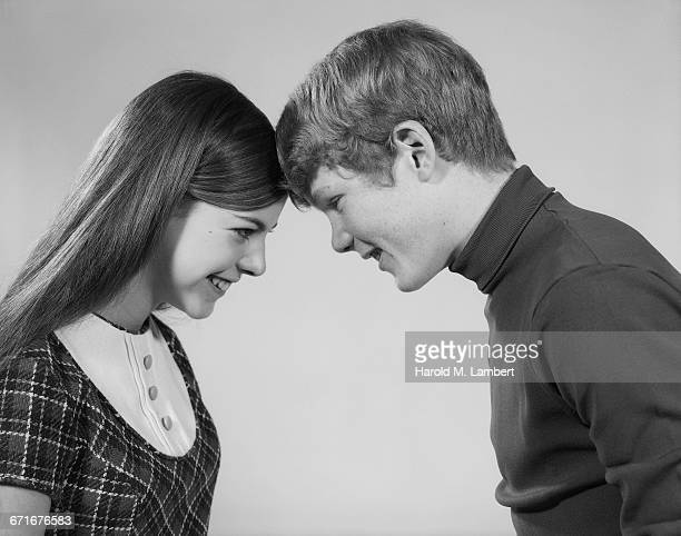 portrait of boy and girl head to head - {{relatedsearchurl(carousel.phrase)}} ストックフォトと画像