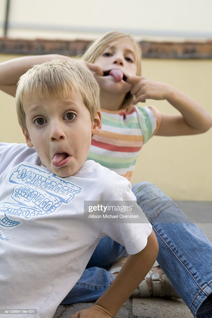 Portrait of boy (4-5) and girl (8-9) making faces : Foto stock