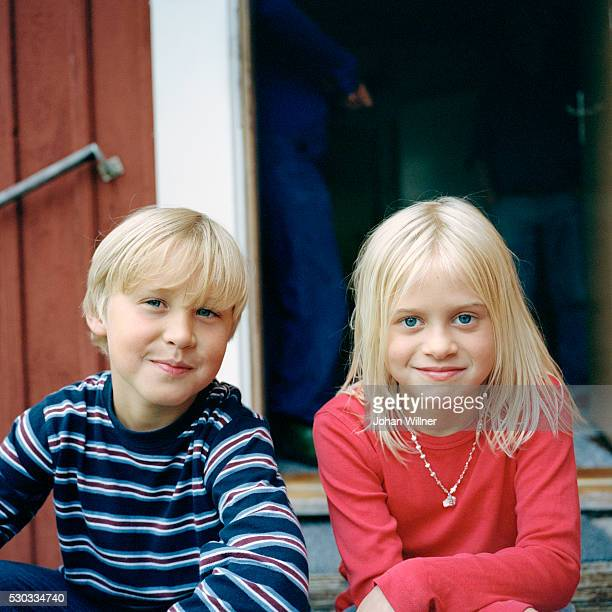 Portrait of boy and girl on porch