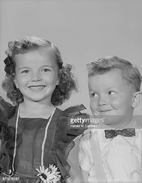portrait of boy and girl smiling - {{relatedsearchurl(carousel.phrase)}} ストックフォトと画像
