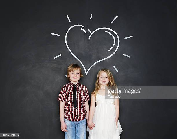 Portrait of boy and girl with love heart