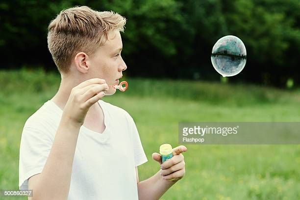 Portrait of boy blowing bubbles