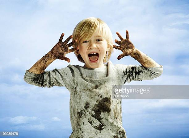 portrait of boy covered in mud - hygiene stock pictures, royalty-free photos & images